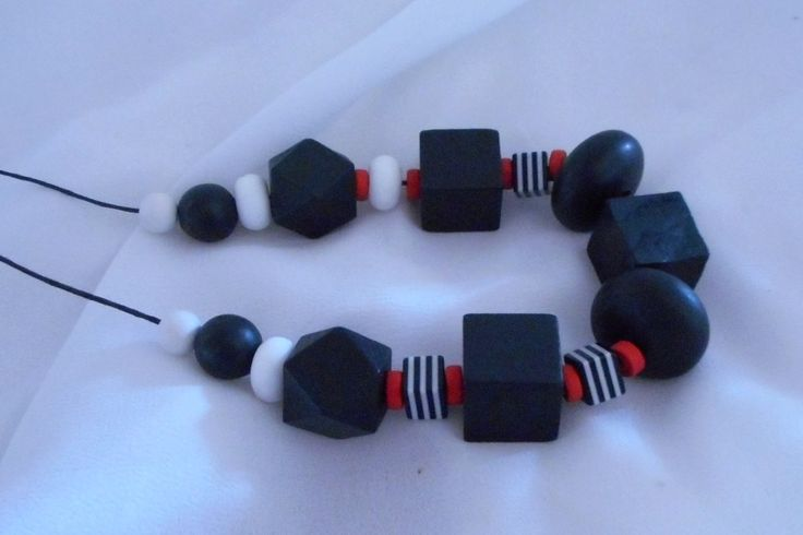 JakDesigns Black Necklace Black wooden beads make up most of this stunning necklace $40