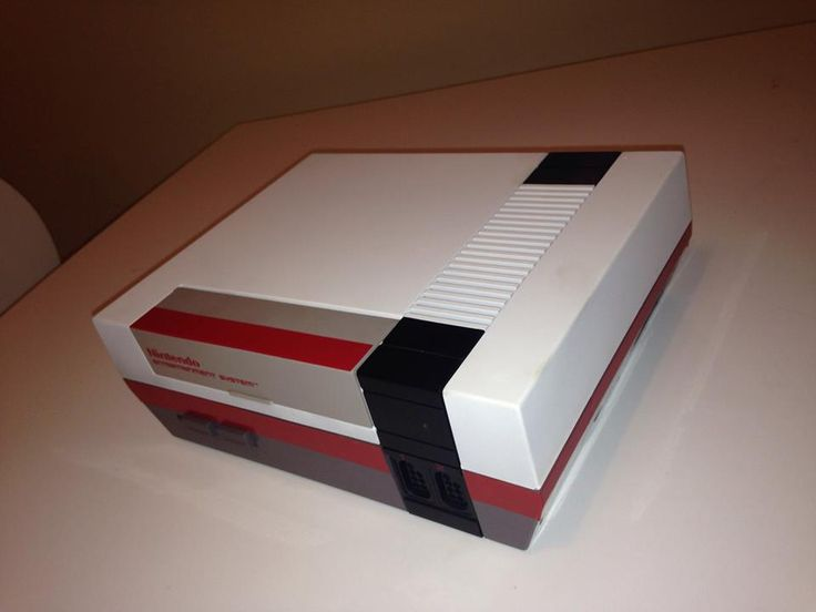 White and Red NES unlocked console. Made by Retro Refabricators