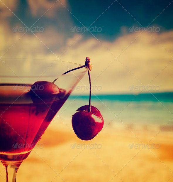 Cherry Cocktail ... <p>Cherry cocktail on the beach in retro style</p> Aperitif, alcohol, alcoholic, ambiance, background, bar, bartender, beach, beverage, booze, caipirinha, cherry, citrus, clubbing, cocktail, cold, drink, fruit, garnish, glass, holiday, ice, instagram, juice, lime, liquid, liquor, lounge, margarita, martini, ocean, orange, party, refreshment, restaurant, retro, rum, sand, sea, seaside, shore, shot, sky, summer, travel, tropical, vacation, vintage, vodka, water