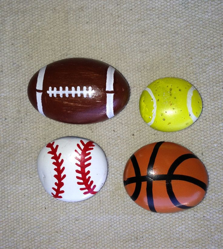 Small sport hand painted stones...these would be cute as dresser pulls for a boys bed/playroom