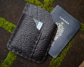 Hand Stitched French ID Wallet and Credit Card  Holder made of Tumbled Bull Hide. $48.50, via Etsy.