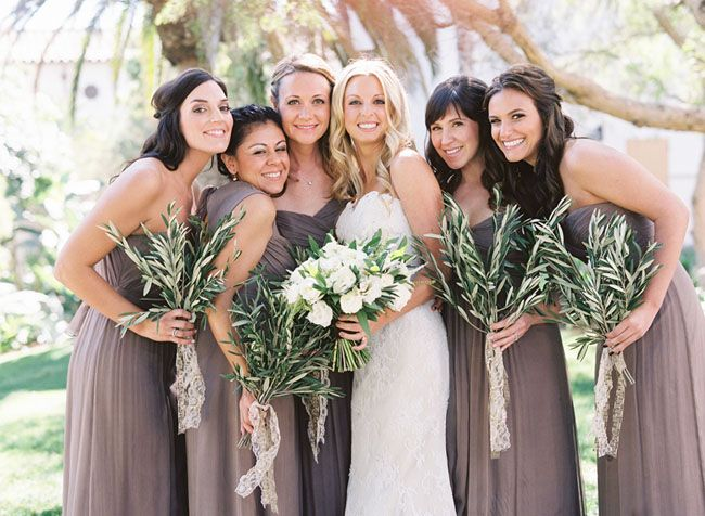 Bridesmaids in dusty gray Amsale dresses with olive branch bouquets