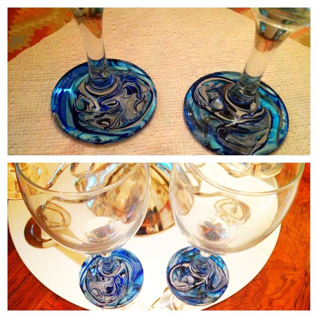 Marble DIY wine glasses. Afternoon crafts! Just did this. Same process as water marbling your nails. Dollar store wine glasses, tape top of glass to keep nail polish only in bottom , dip into marble design, hold under water for a couple minutes, leave out to dry!