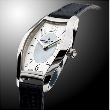 Serenade An Elegant Statement  Like the whisper of a sonata in the open midnight air, the Serenade ladies' watch can be akin to the perfection of a musical performance to serenade the ladies. Created by our master watchmakers, the Serenade is presented in a beautiful oblique-shaped stainless steel case with a cabochon crown. Its fine Swiss Quartz movement and mother-of-pearl silver dial is protected by domed sapphire crystal glass with anti-reflective coating.