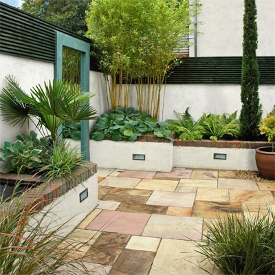 In this courtyard design it's the plants that are the stars of the show - with contrasts in forms, shapes & textures. Imagine it without them!