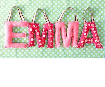 Button Letters    Perfect for a little girl's room, these felt letters are embellished with an assortment of pink vintage buttons.  Editor's Tip: Make sure to sew the buttons on the front of the letter first, before sewing the letters together.