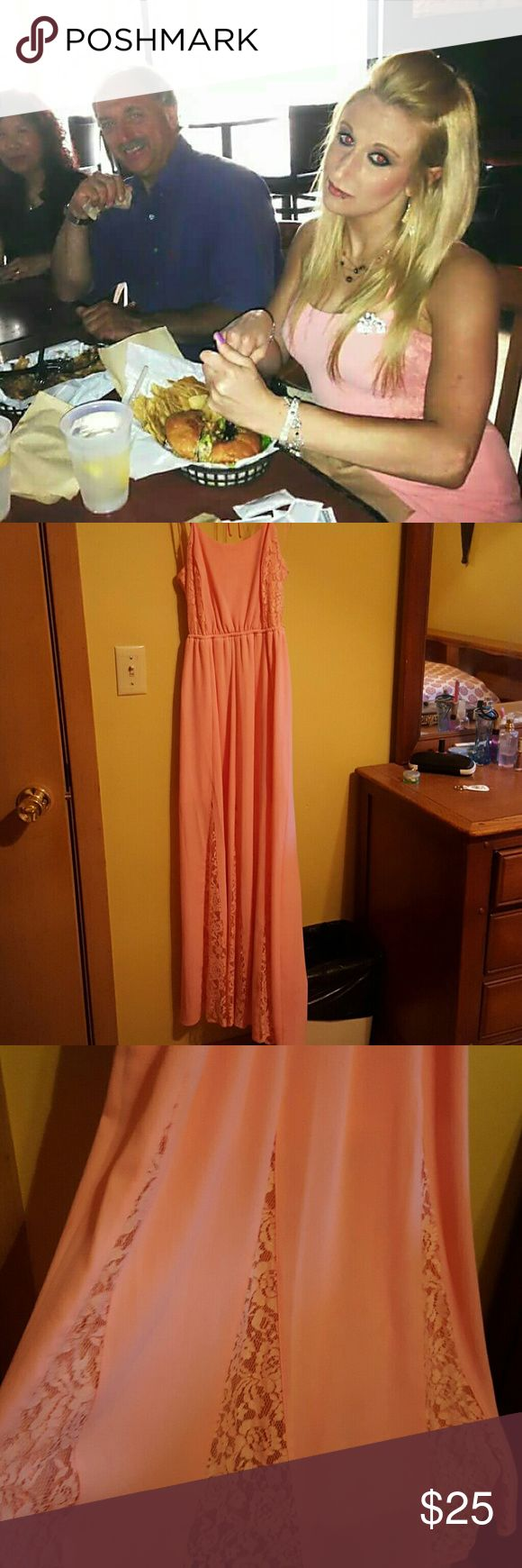 Summer sundress Light pink/peach beautiful strappy summer sundress. Skirt flares out on bottom with interior lace accent. Only worn once. No damage, like new. I have pics of me wearing it. Please comment to inquire and I'll get them to you. Candie's Dresses