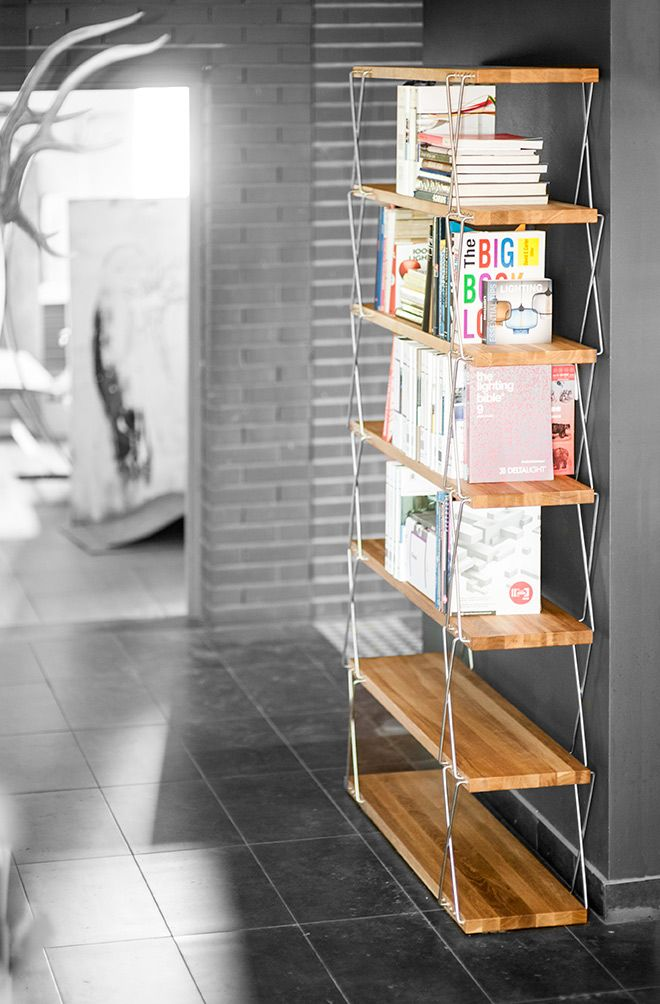 The bookcase may be both positioned by the wall and be free-standing, dividing the space. Made of oiled oak tree. Design covered by European patent.  #design #workshop #MustHave #Award #Handmad #woodwork #craftsmanship #interiordesign