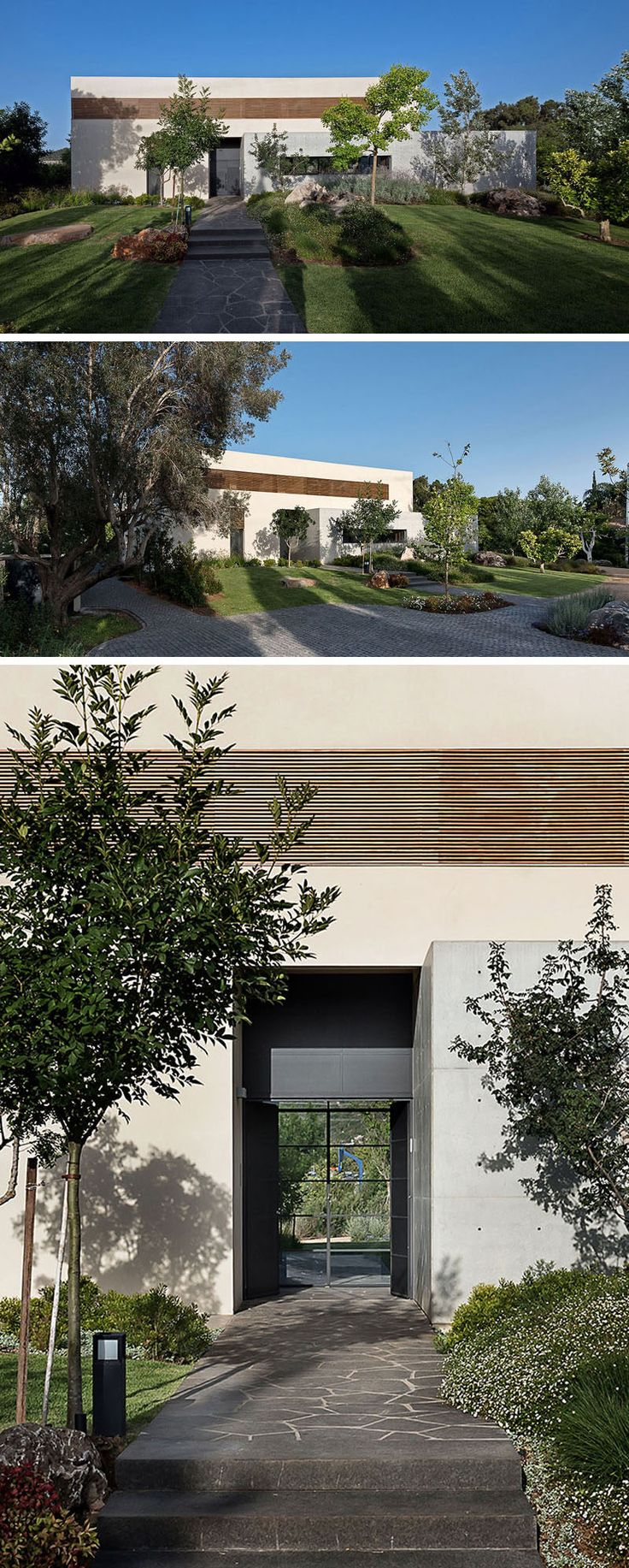 At the front of this modern house, a stone path leads through the garden to the front door. #Landscaping #GardenPath #FrontDoor