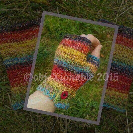 Tunisian crochet fingerless mittens in rainbow wool.