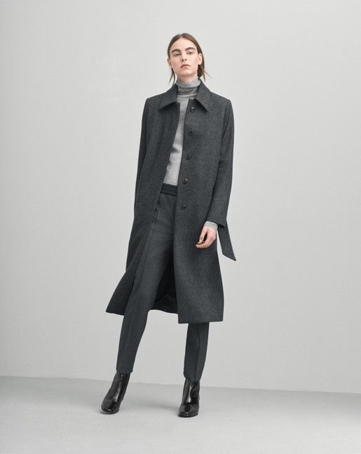 A classic collar coat in a soft wool. Slightly A- lined shape with a tone in tone belt at waist for a feminine shape. Longer mid-calf length.  <br><br> - Soft Wool<br> - Longer length<br> - Feminine, slightly A-line fit<br><br>  The model is 179cm an