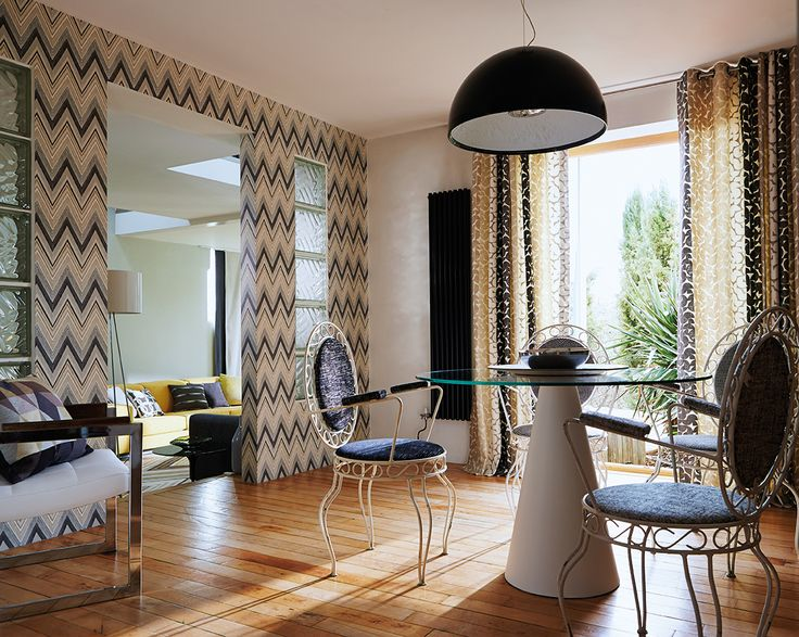 Scion's 'groove' wallpaper, featuring tonal zig zags makes a real statement in this retro inspired dining area!