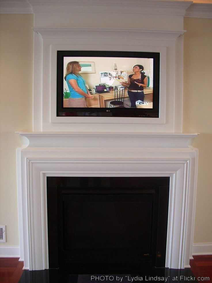 Corner fireplace mantel with tv above woodworking for Tv over fireplace