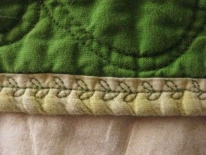 I already do this, but haven't tried this leaf stitch yet. Decorative stitches on binding instead of hand stitching.....great idea and adds interest to quilt!