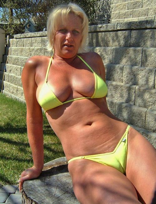 Mature woman blue bikini that interfere