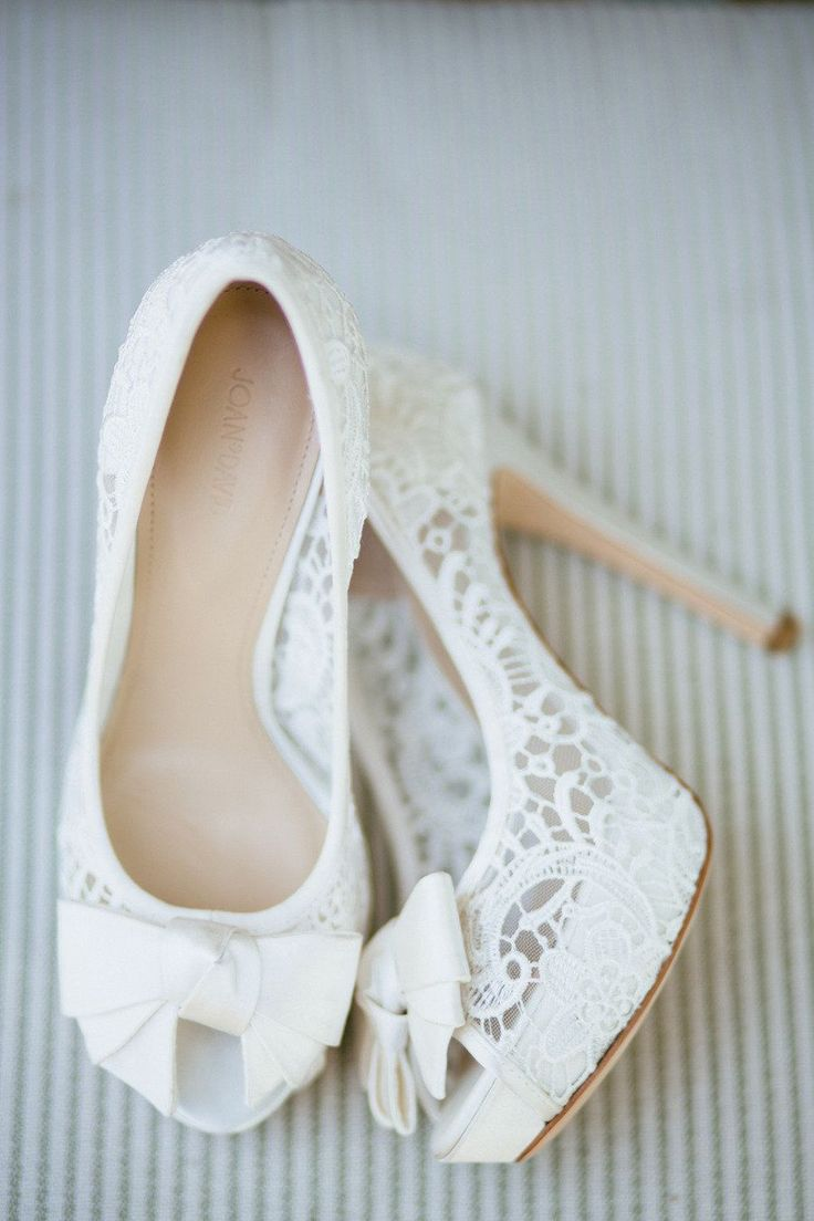 Lace peep toes from Joan & David.   Read more - http://www.stylemepretty.com/california-weddings/2013/08/08/laguna-beach-wedding-from-sara-and-rocky-photography/
