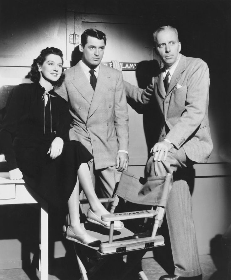 Rosalind Russell, Cary Grant and Howard Hawks on the set of His Girl Friday (1940).
