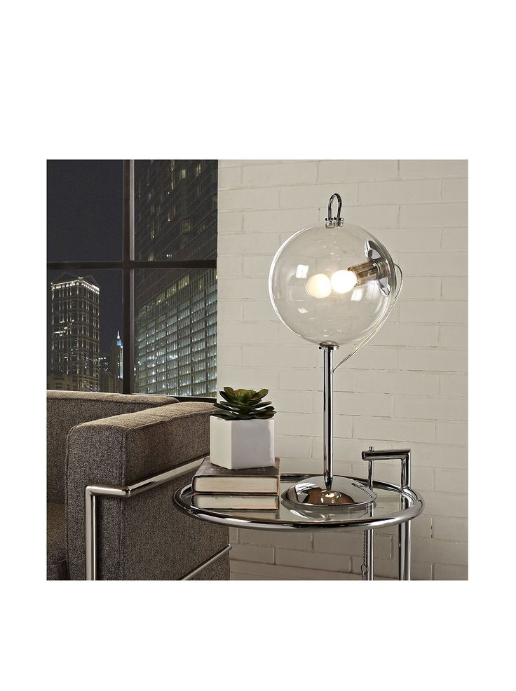 let the natural radiance of light shine in your home with the cheer modern table lamp this polished table lamp features a transparent glass shade - Modern Table Lamp