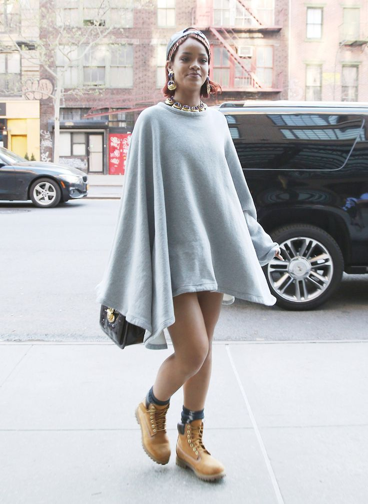 Rihanna in a grey poncho and Timberland boots -- queen of everything