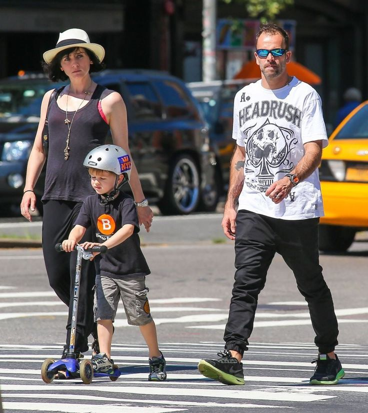 Jonny Lee Miller, his wife Michele Hicks and their son Buster Timothy Miller, out for a stroll in NYC