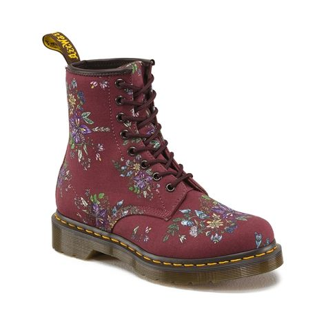 The 8-eye Castel boot is offered from Dr. Martens in a Belladonna Fine Canvas.The design of the Castel upper is based on British wild flowers, with the name literally meaning 'Deadly Nightshade'.  The contrast of a soft, decorative floral with this sinister edge is typical of Dr. Martens' rebellious history. Features include the famous Dr. Martens air cushioned sole, and Goodyear welt. Part of the core print collection from Dr. Martens!   Available online only at Journeys.com and Shi by…