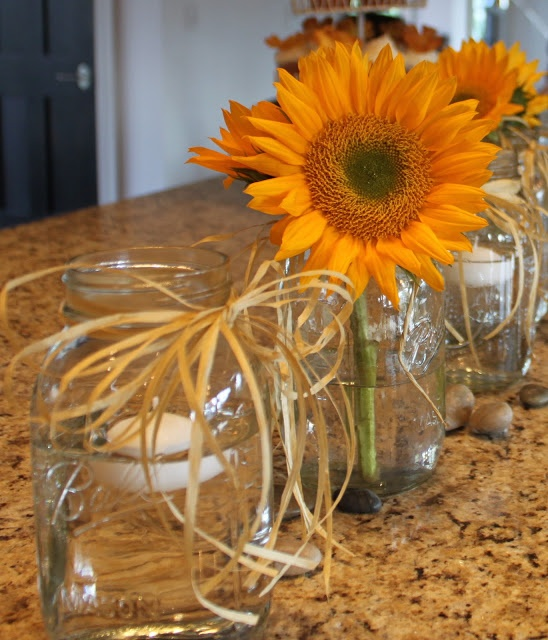 Thanksgiving table-scape idea - alternate mason jars with floating candles