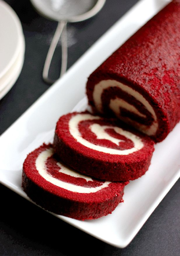 best red velvet cake roll; made with oil, buttermilk and vinegar, along with the cake flour, to ensure a tender and moist roll; filled with cream cheese buttercream