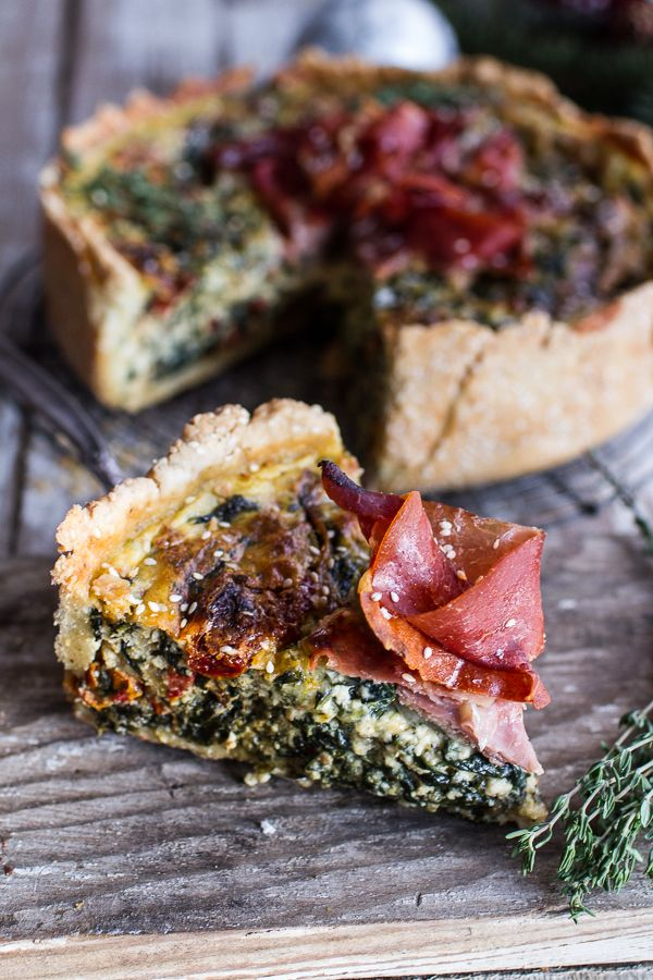Deep dish spinach and prosciutto quiche with toasted sesame crust