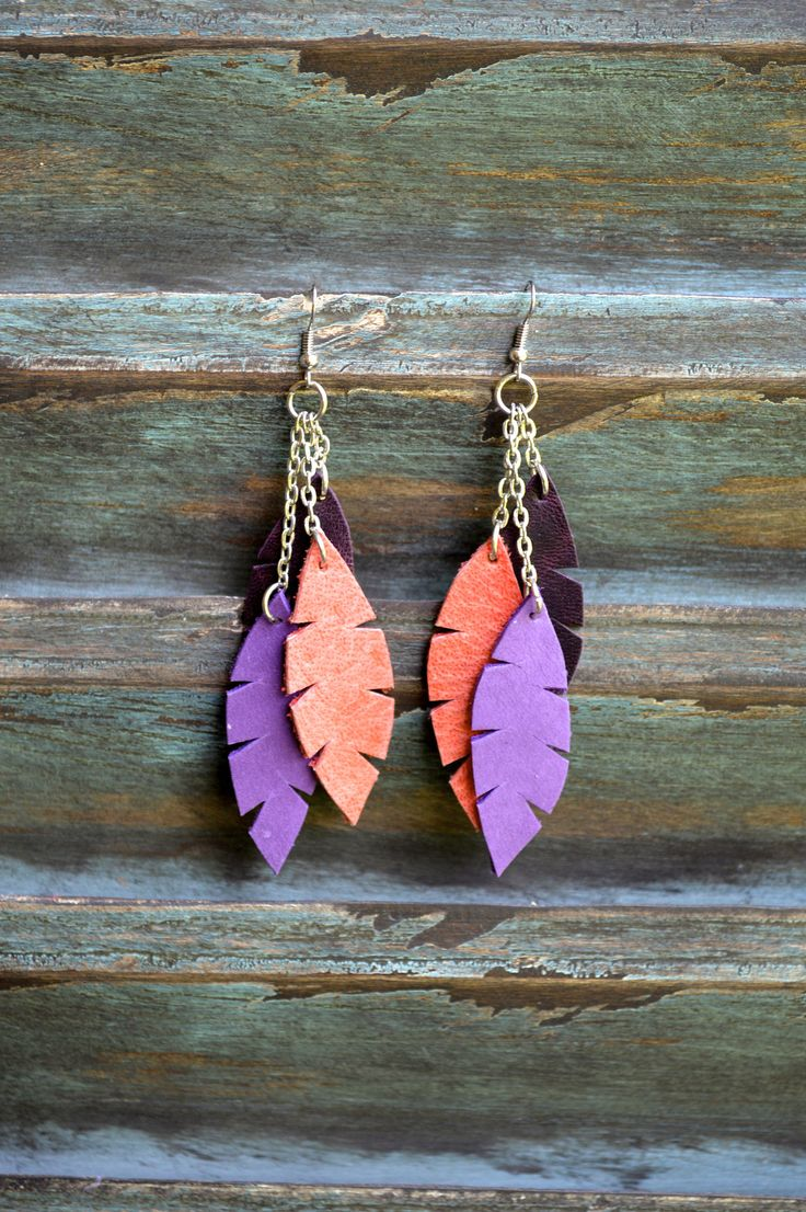 purchase effect... handmade leather earrings from thailand. $15