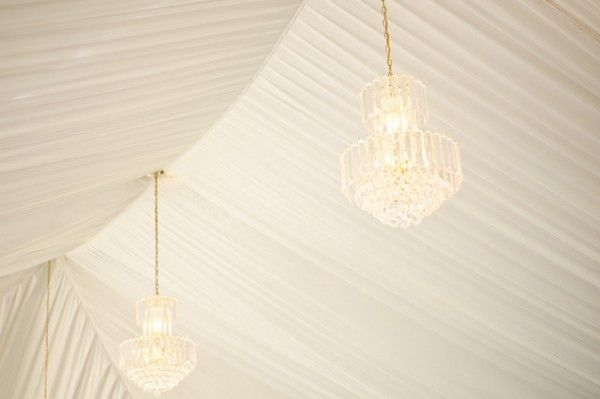 chandeliers in a reception tent | Carmen Salazar Photography