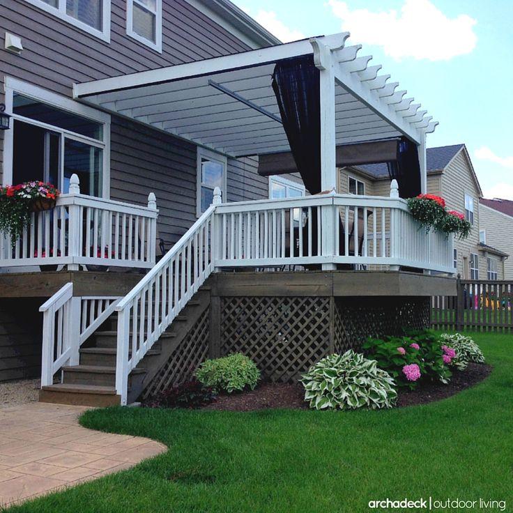 Raised deck designed with lattice skirting, mosquito curtains and shade pergola.