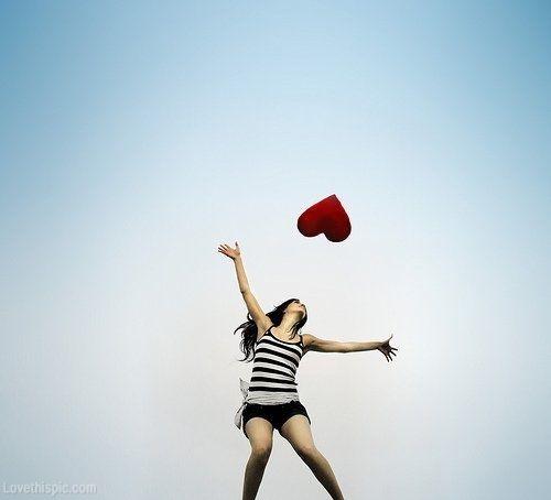 Catching a heart sky girl outdoors heart