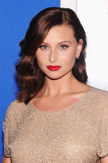Aly Michalka - sheer flawless base, freckles peeking through, juicy red lip, cat liner