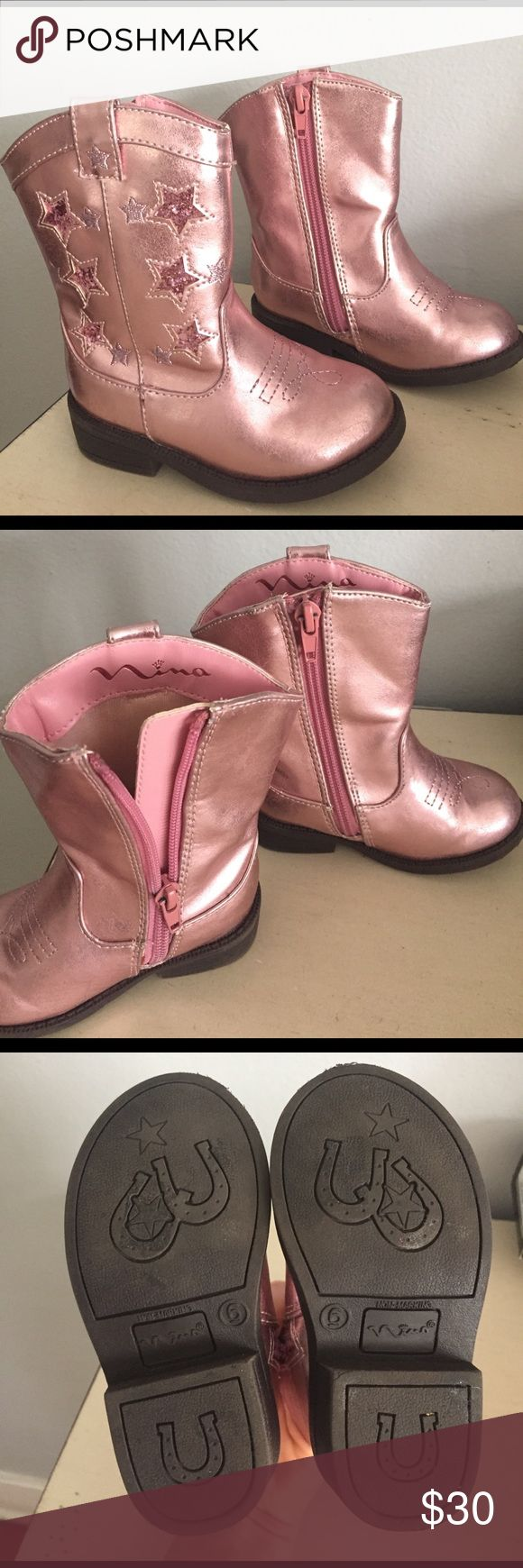 Nina Kelis cowboy pink cowgirl boots star design So cute she'll never take them off! The Kelis Star western boot from Nina is one show stopping boot that will make all eyes turn to her when she enters the room, thanks to the fun metallic upper and glitter accents. There is some slight wear as you can (hardly) see in the pics. One tiny scuff on the toe & on the top front fold Metallic synthetic upper Pull-on style, side zipper for secure fit Side pull tab for easy on and off Glitter star…