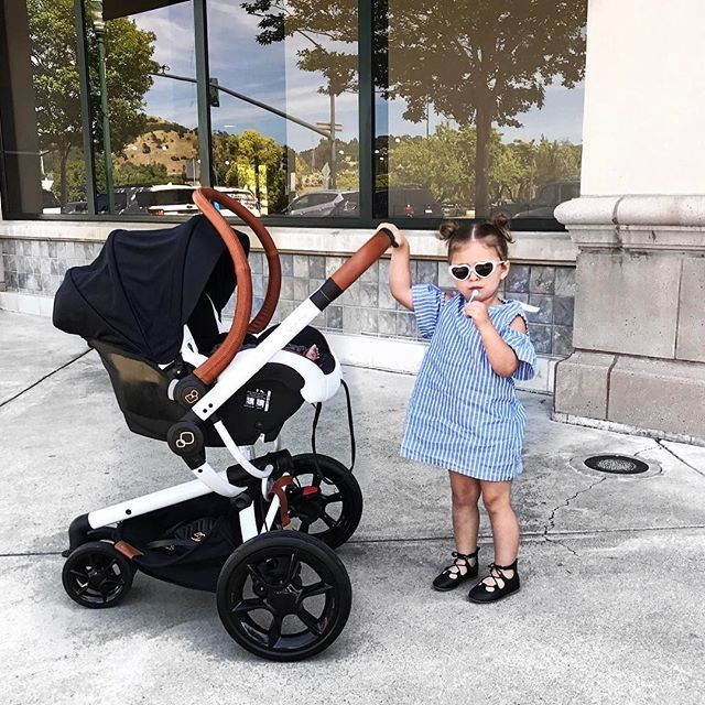 Chicest mama in the making + best little helper . Dress: @dukesanddarlings Stroller: @quinnyworld Car Seat: @maxicosiusa