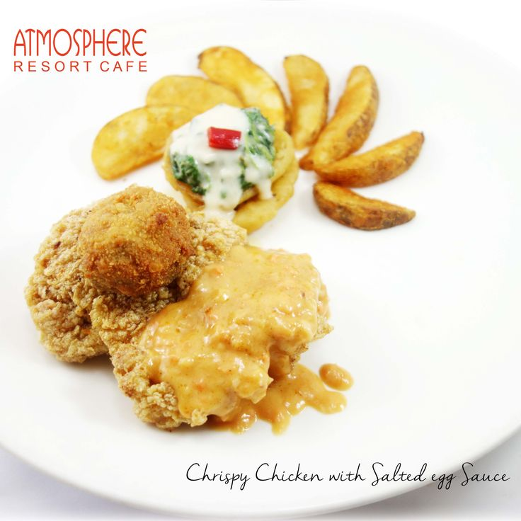 Breaded chicken thigh with potato wedges, crispy fried mushroom, creamy spinach & onion ring  in savory salted-egg-sauce