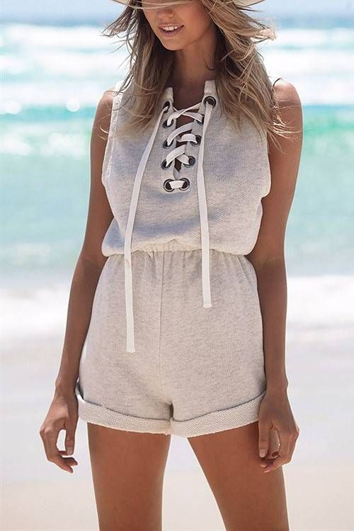 Feel the breeze this summer with lace-up front playsuit . It features sleeves , lace-up front details and strechable wasit . Enjoy your summer vacation with this lace-up front playsuit .