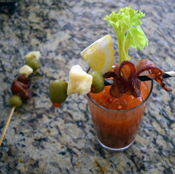 """Esquire recently posted a primer to the Perfect Bloody Mary, and we were inspired by their call to mix it up! (Recipe: http://bit.ly/2n7a50X) For our """"Smokey Mary,"""" we swapped out horseradish for sauce from a can of chipotle in adobo and topped our cocktail with a skewer of Smokey Cheddar, bacon and olive."""