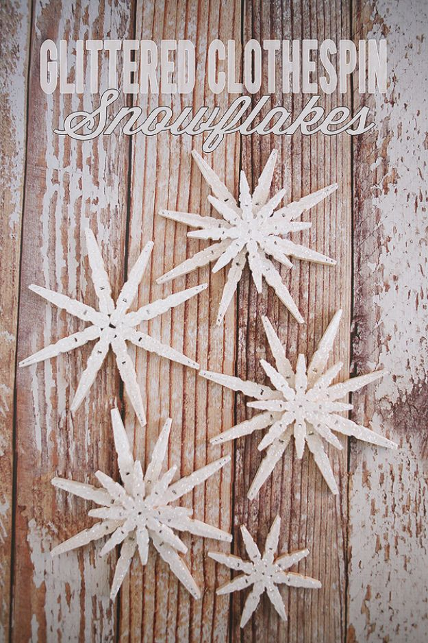 Best DIY Snowflake Decorations, Ornaments and Crafts - Glittered Clothespin Snowflakes - Paper Crafts with Snowflakes, Pipe Cleaner Projects, Mason Jars and Dollar Store Ideas - Easy DIY Ideas to Decorate for Winter - Creative Home Decor and Room Decorations for Adults, Teens and Kids http://diyjoy.com/diy-projects-snowflakes