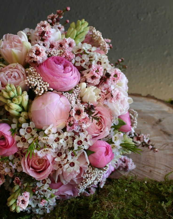 Peonies, garden roses, tuberose, tulips, wax flowers, rice flowers, and ming branches make up this vintage-looking bouquet. | Floral design by Bows and Arrows