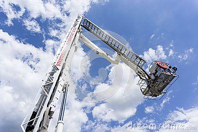 Ladder of a Fire engine ladder truck in air on a firefighting show in Austria, Eisenstadt.