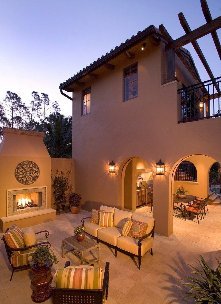 house outdoor design patio mediterranean with beige stucco siding black freestanding stoves
