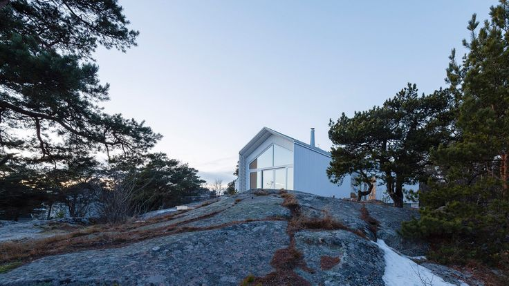 Architecture studio Mer Arkkitehdit have integrated rocky terrain into the design of this spruce-clad villa in the historic Finnish seaside town of Hanko