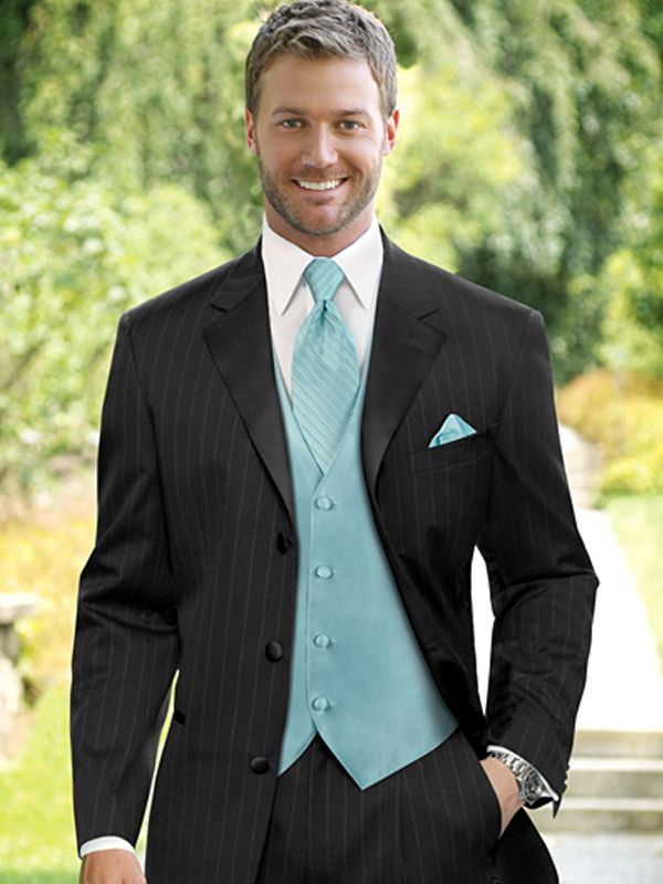 Spectacular Groomsmen in pinstripe tux with vest tie u handkerchief matching bridesmaids dresses