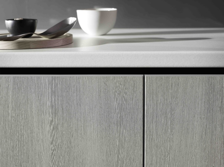 Benchtop Laminex Impressions Fresh Snow Spark finish and base cupboard doors and panels Laminex Impressions Bleached Wenge Riven finish. Styling Wendy Bannister. Photography Earl Carter.