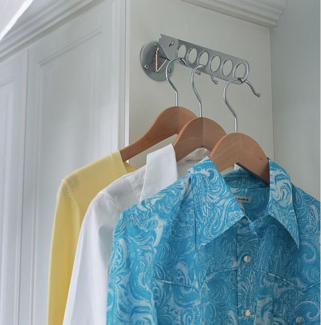 Don't have space for a full hanging rod? Hang a valet rod in an odd nook or corner. | 31 Ingenious Ways To Make Doing Laundry Easier