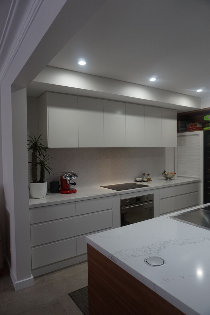 Two tone kitchen Gripless handles Tile splash back stone bench top Lift up power point pack in island