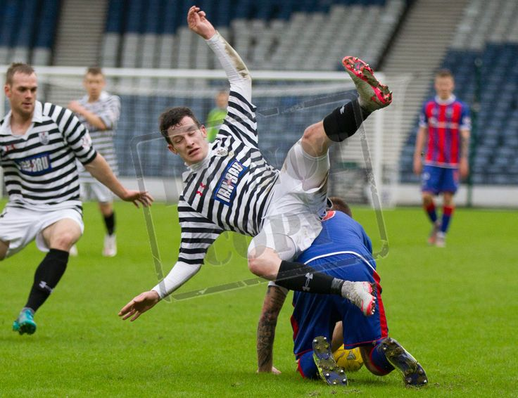 Queen's Park's David Galt is upended during the SPFL League Two game between Queen's Park and Elgin City.