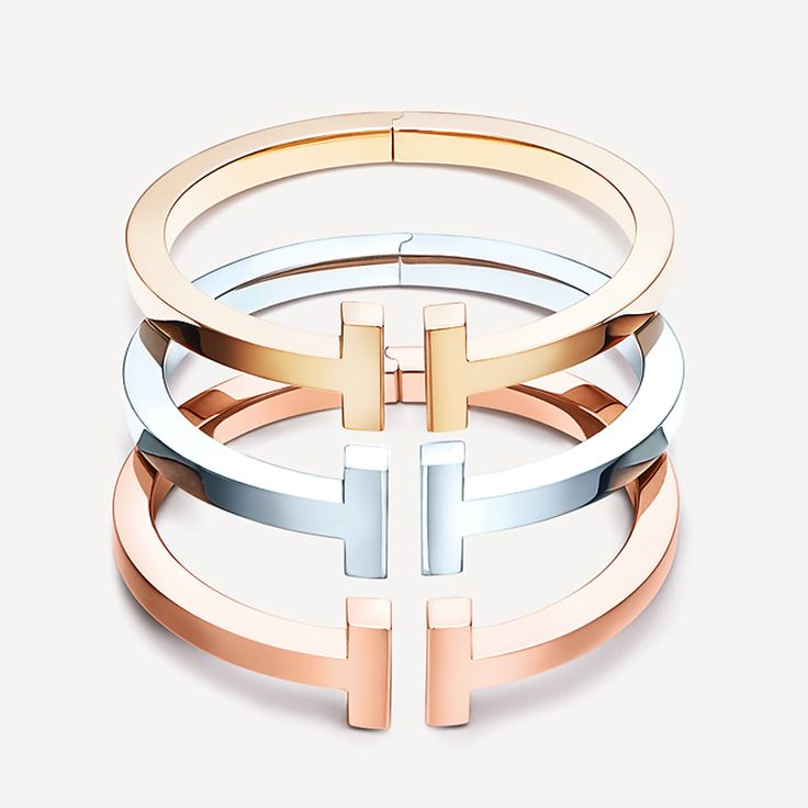 Tiffany T square bracelets in 18k yellow gold, sterling silver and 18k rose gold. #TiffanyPinterest #TiffanyT