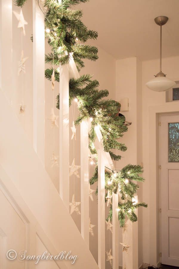 25 best ideas about christmas staircase on pinterest for Hanging garland on staircase
